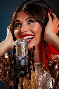 woman singer with headphones