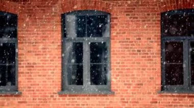 Falling snow with window and brick wall background