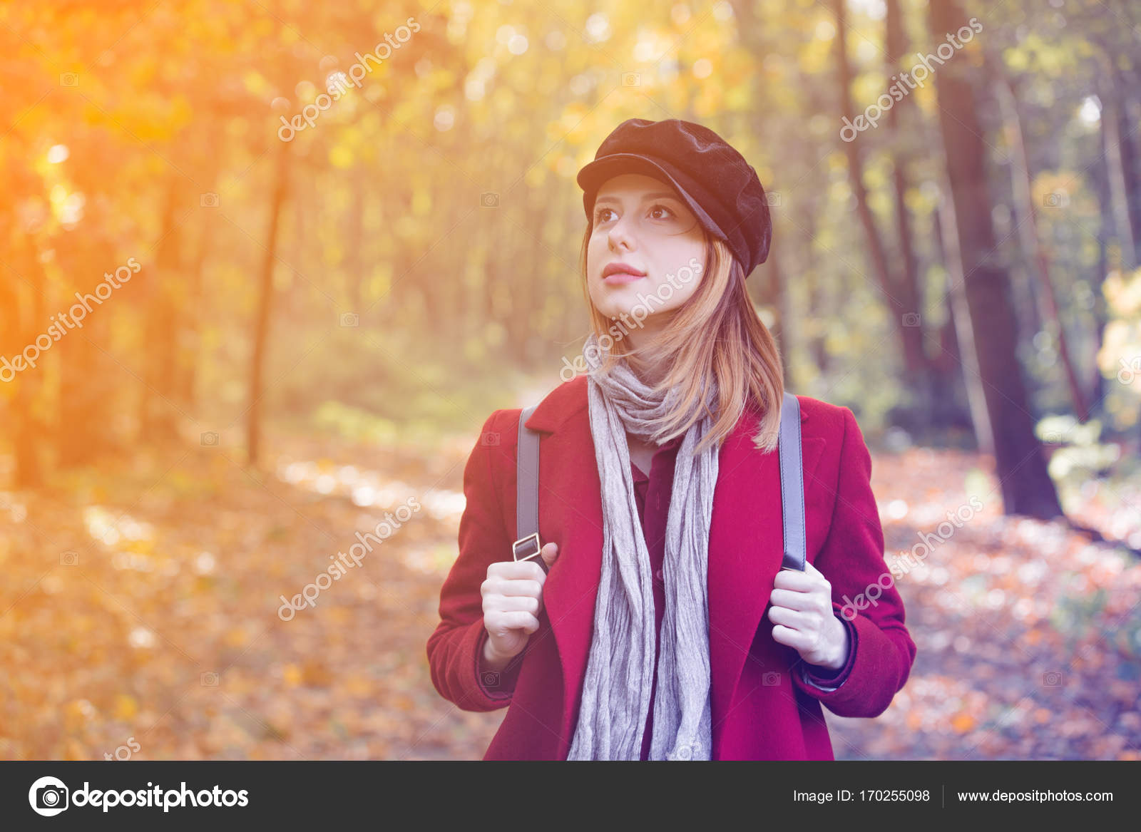 38b7719b7b Young redhead woman in red coat and backpack have a rest in autum park —  Photo by ...