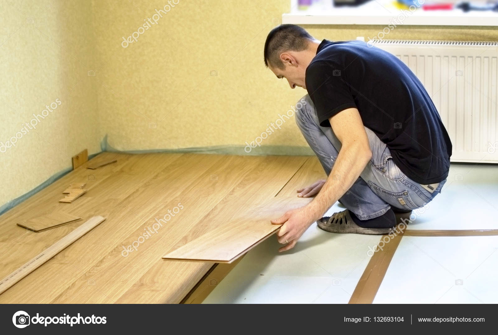 The Process Of Installing Laminate Wooden On Floor Stock Photo
