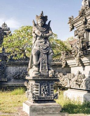 Persons Balinese gods on Bali island