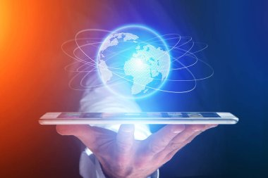 Businessman holding smartphone with globe sphere hologram going