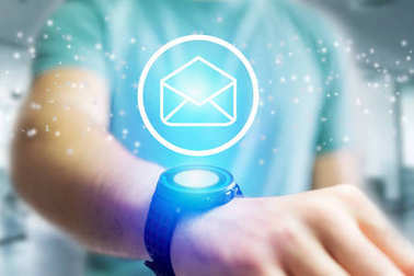 Email icon going out a smartwatch interface - technology concept