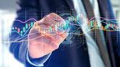 Pohled na podnikatel drží 3d vykreslení burze obchodování dat informační displej na futuristické rozhraní