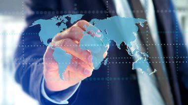 View of a Businessman holding a Connected world map on futuristic interface - 3d render