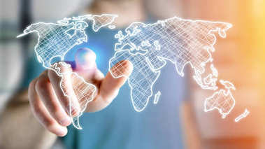View of Businessman holding Hand drawn world map on futuristic interface