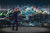 Fotografie Pohled na podnikatele před zdí s vykreslení burze obchodování dat informační displej