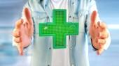 Fotografie View of man holding lighting pharmacy cross and stethoscope