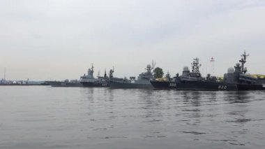 Warships of the Baltic fleet in the middle of the harbour, cloudy july afternoon. Kronstadt