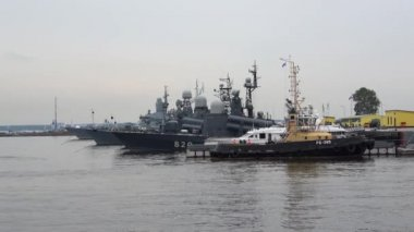 The ships of the Baltic fleet in Kronstadt Harbor, cloudy july afternoon. Russia