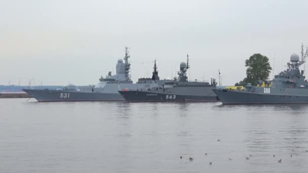 Warships of the Baltic fleet in the harbour of Peters, cloud day in july. Kronstadt