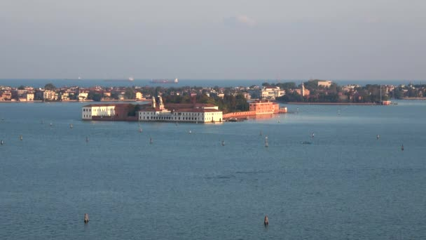 View on the island of Sacca Sessola (Isola delle Rose) in the Venetian lagoon, evening. Italy