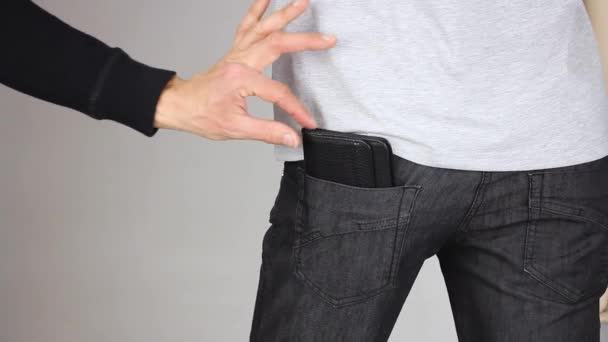 Pickpocket stealing a wallet