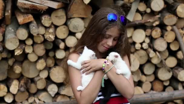 girl holds in hands kittens