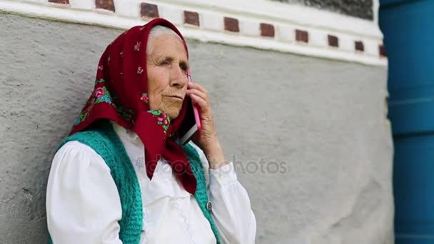 Senior woman talks on mobile phone