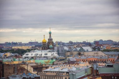 View from the Colonnade of the Saint Isaac's Cathedral in St. Petersburg, Russia, roofs and the Savior on blood and the doms of the Savior on blood cathedral