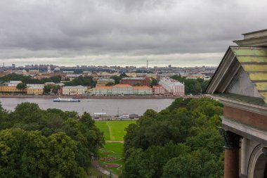 View from the Colonnade of Saint Isaac's Cathedral in Saint-Petersburg, Russia, State University main building and the Neva river in Saint-Petersburg