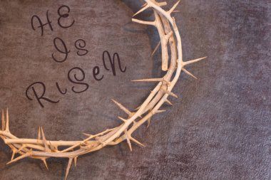 Easter He is Risen Quote surrounded by a Crown of Thorns on a te