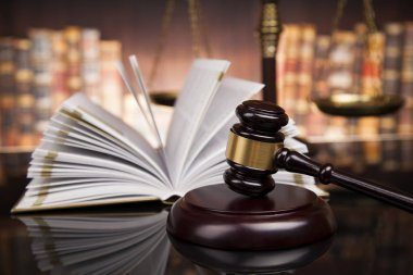 Law books, mallet of judge