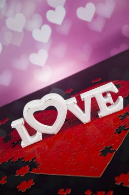 Wooden letters love and heart