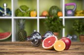 dumbbells and fresh fruits