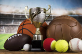 Trofej pohár a sportovní míč pozadí