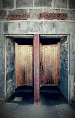 aged doors in toilets