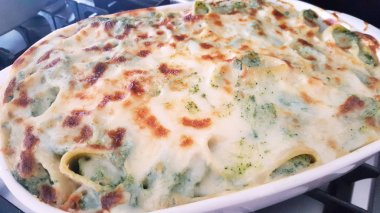 Cannelloni topped with melting cheese