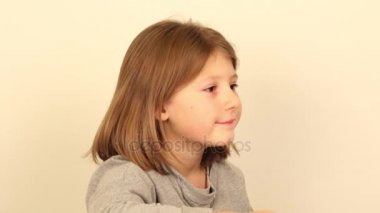 a little girl laughs