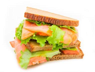 Sandwich with smoked salmon,salad and lemon stock vector