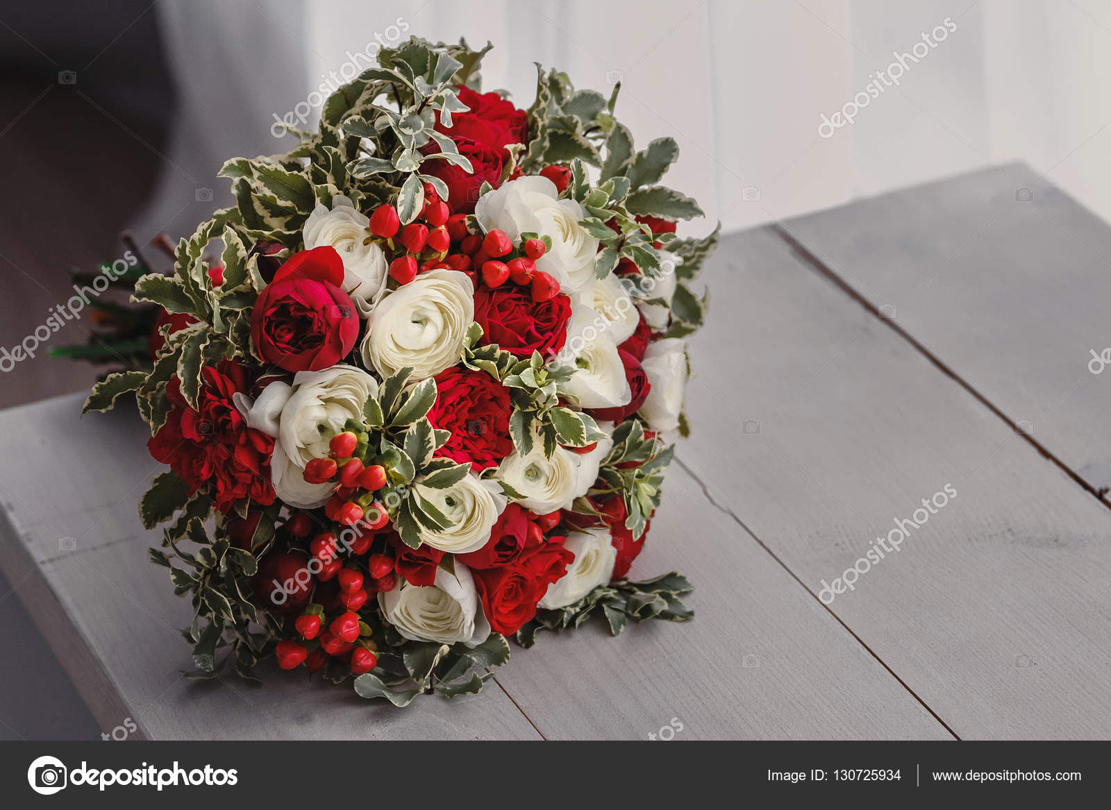 Red And White Autumn Wedding Bouquet With Berries On The Bench