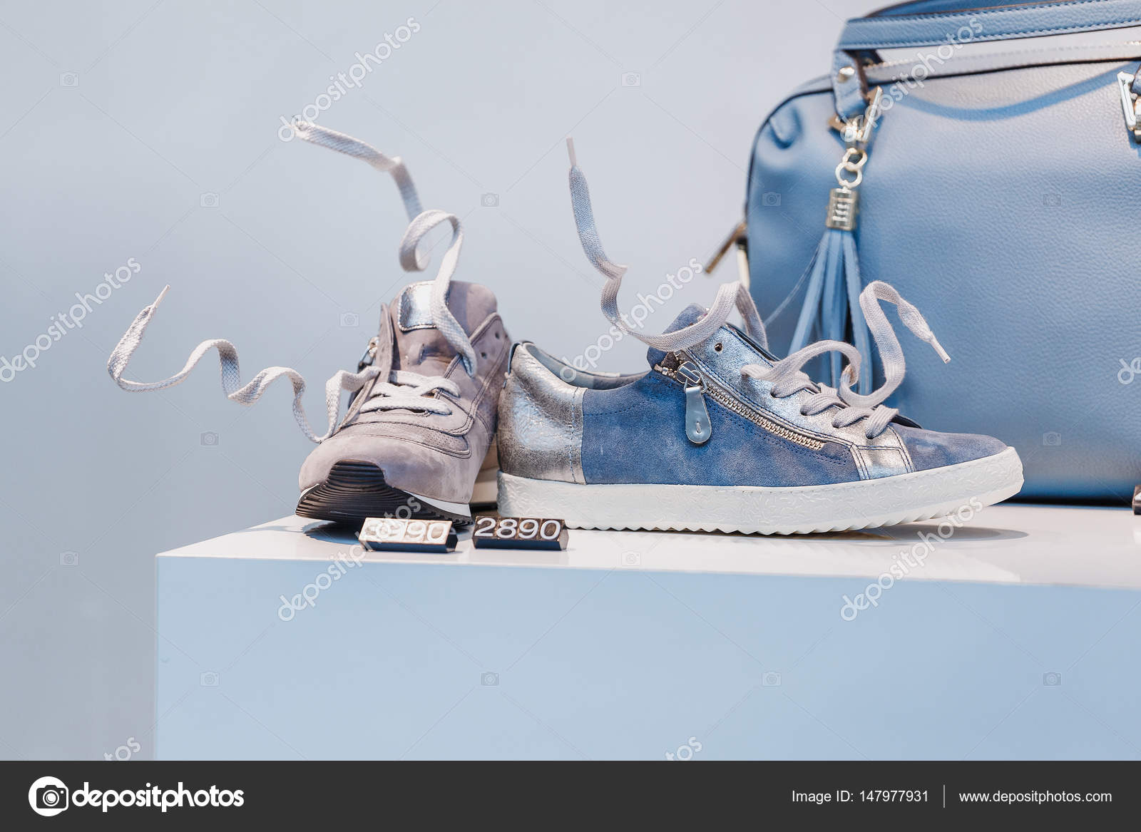 Showcase Of A Fashion Store With Casual Futuristic Shoes And A Bag With A Price Tag Stock Photo C Frantic00 147977931