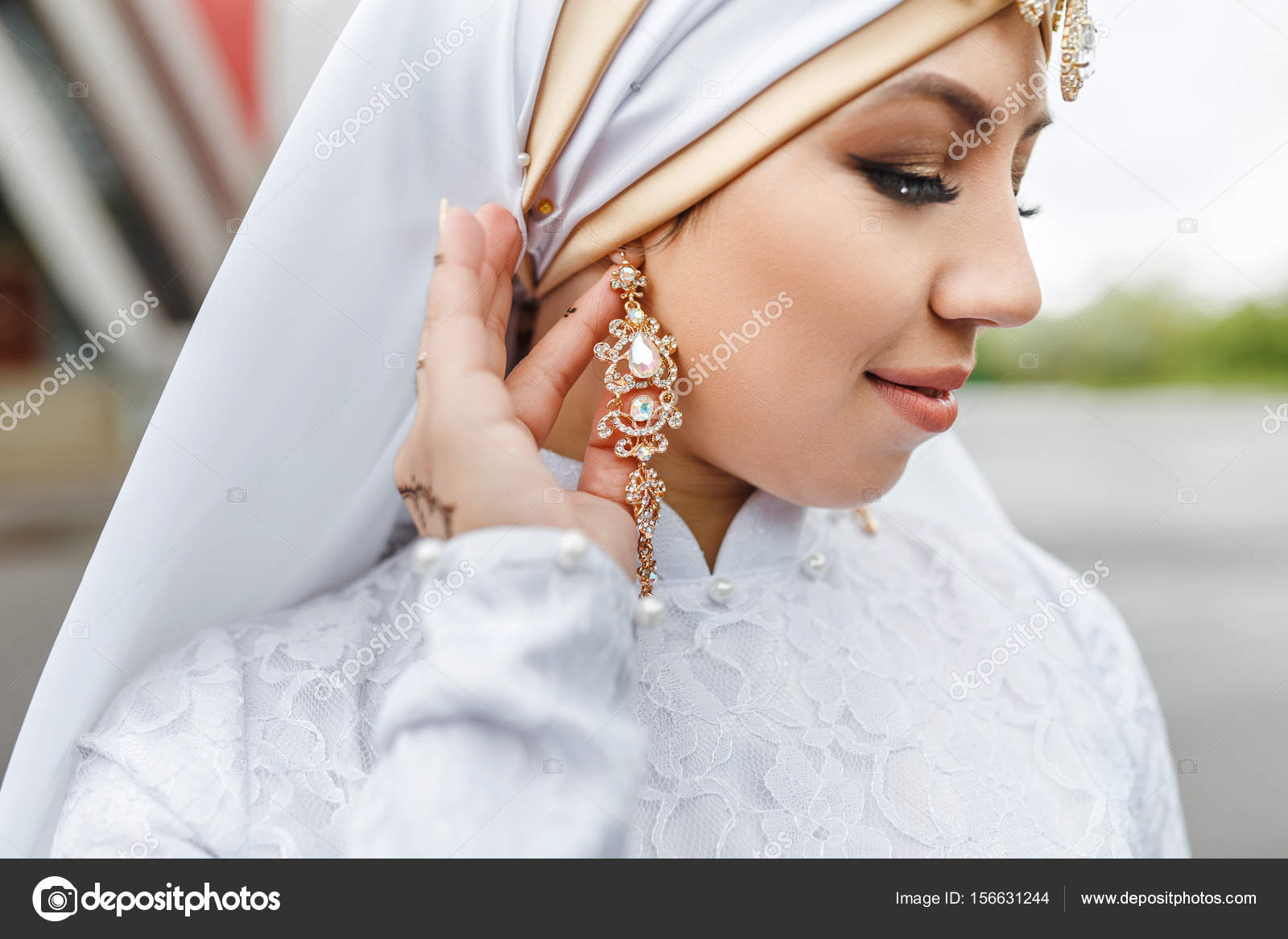 Charming muslim arabic bride in nikah wedding dress and hijab headscarf,  close-up on jewelry and earrings 20