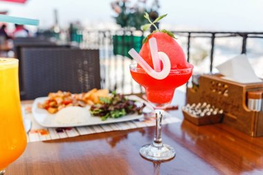 Watermelon drink in glass in city cafe or restaurant