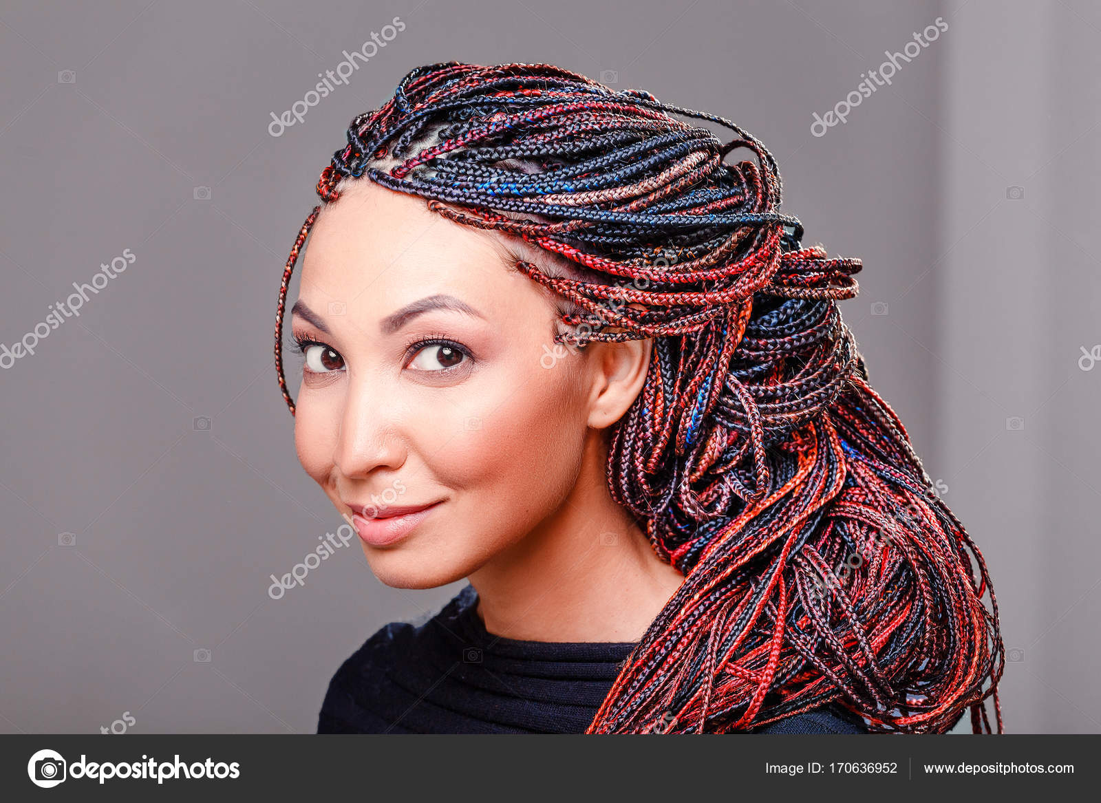 Women Hairstyle with colorful hair extensions braided in thin ...