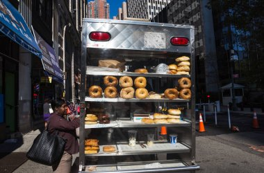 Fat black woman buys buns on the streets of Manhattan