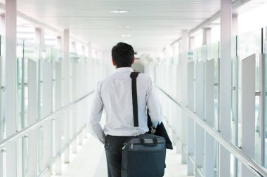businessman walking at airport