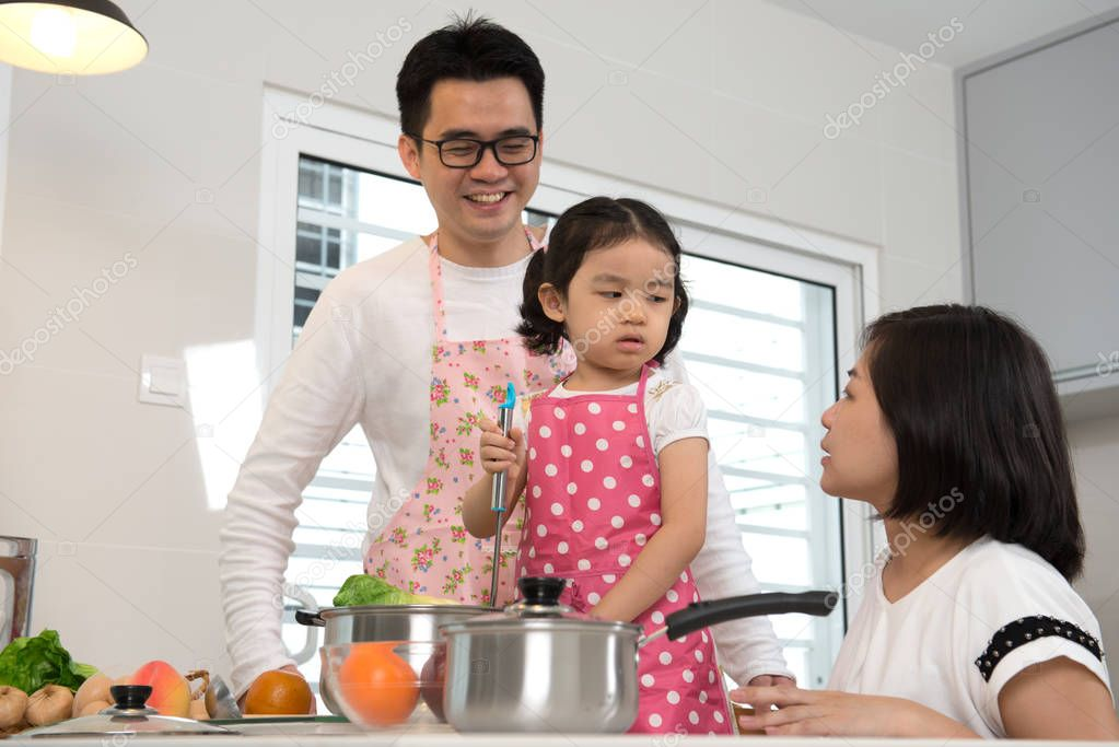 family cooking at kitchen