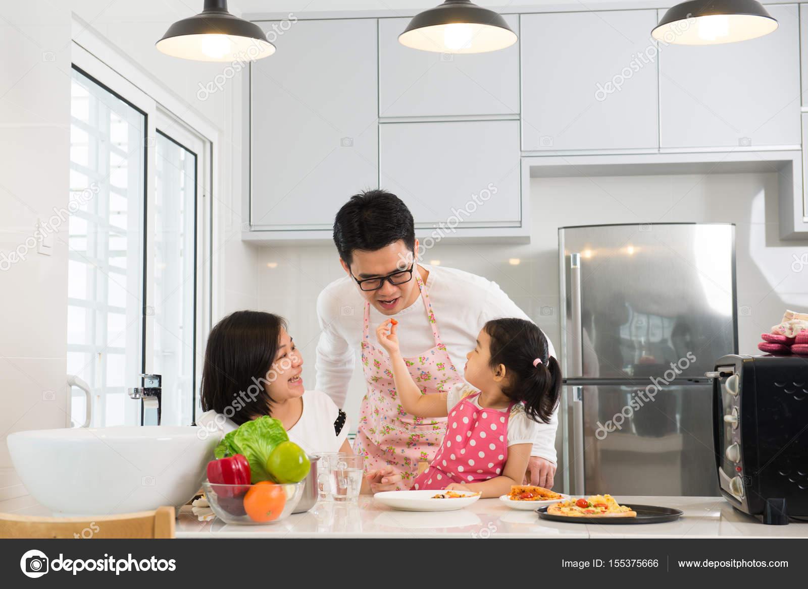 asian family cooking at kitchen — Stock Photo © yuliang11 #155375666