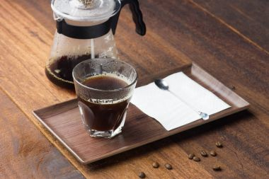 coffee dripping on wooden background