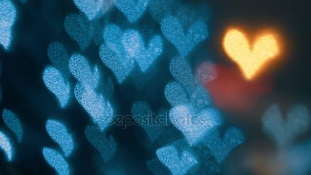 Indicatori luminosi defocused di garland nella notte