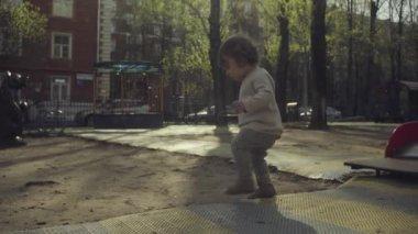 A kid walking in the courtyard