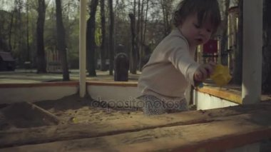 A kid playing in a sandbox