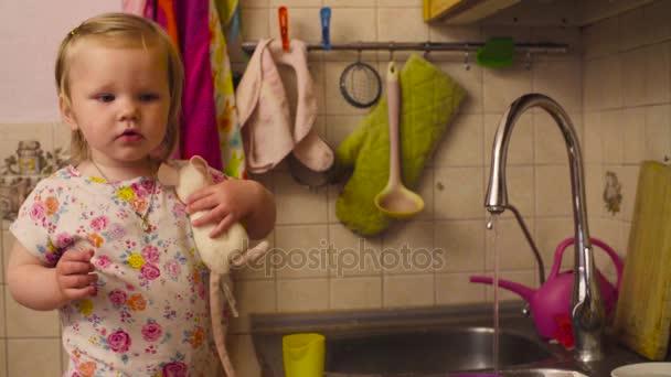 Little baby girl standing near kitchen sink — Stock Video © chudakov ...