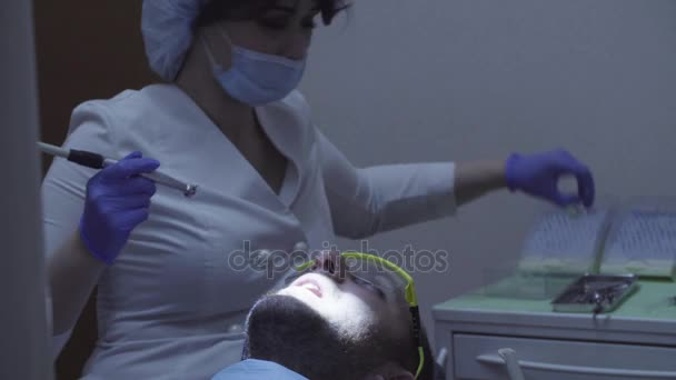 Dentist drilling tooth in dental clinic