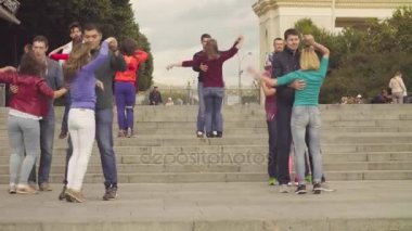 Dance in Moscow. People dancing on the stairs