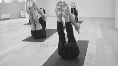 Yoga class. Ubhaya padangusthasana