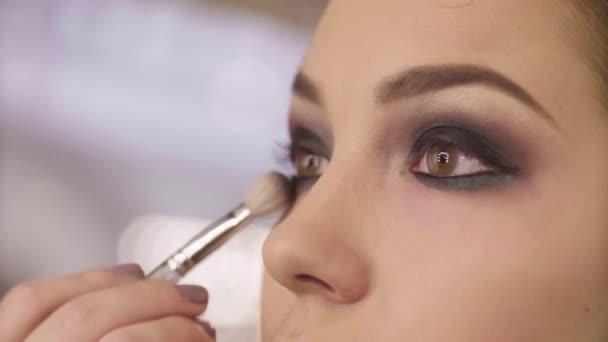 The makeup artist shading eyeshadow