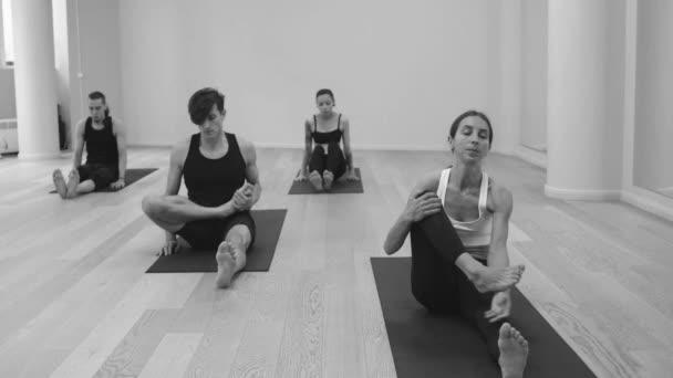 Yoga class. People doing yoga asanas