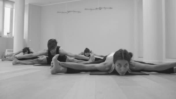 Yoga class. Wide angle seated forward bend